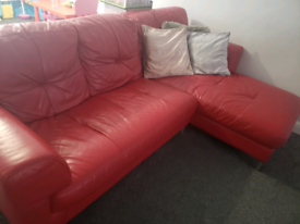 Red leather sofa and swivel chair