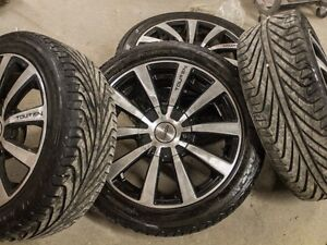 Set of four Michelin Pilot Sport tires ON MAGS