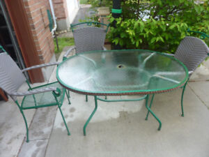 Patio table with 3 wicker metal chairs