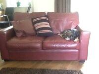 2 burgundy leather sofas