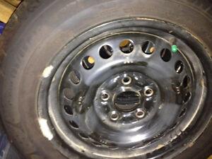 Michelin x-ice Winter Tires on OEM Honda rims with hubcaps Gatineau Ottawa / Gatineau Area image 1