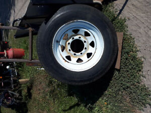 like new 16.5 trailer tire on 8 lug rim