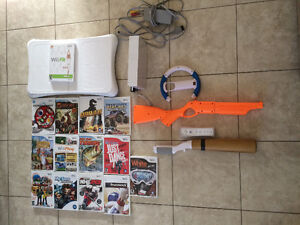Wiit Console + Fit + 15 jeux Mario kart Fusil Baseball Volant