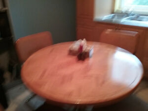 Moving sale   - round pedestal  table with four chairs