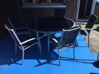5 ft Glass patio table and chairs