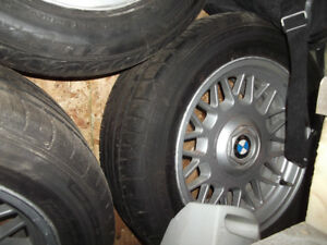 """A Set of 16"""" BMW wheels and Tires with 95 tread on the tires."""