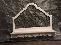 Ornate white wood and curled metal clothes hanger