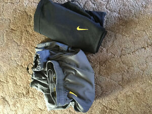 Two pairs of Nike Livestrong edition training pants - like new!