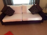 White and purple fabric sofa