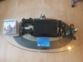 Black Ps3 slim Like new with additional controller and games