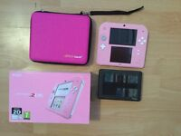 Nintendo 2DS console (pink), box, case, game case and 10 games