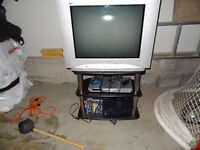 TV and playstation with games and dvd player.