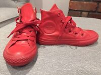Red rubber high top converse