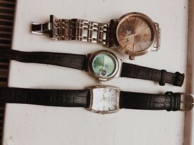 Burberry watch and two leather watches