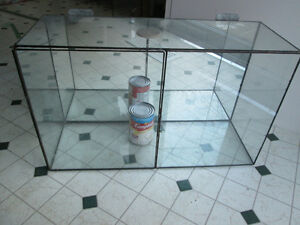 Two One-of-a-Kind Wall Mounted Glass Display Cases