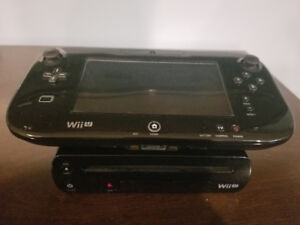 Black Wii U with main controller and 5 games