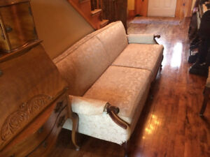 Antique chesterfield and chair, circa 1950