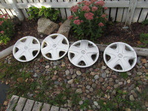 Four Toyota hubcaps 15 inch