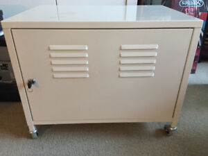 White locking metal storage cabinet on wheels