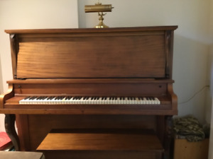 Lindsay upright grand piano in excellent condition