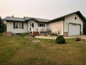 Beautiful bungalow set in private setting on 2 acres.