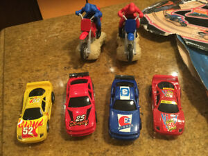 2 Slot Car Racetracks sets / 4 race cars and 2 Motorcycles
