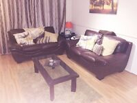 Three Piece Leather Sofa + Leather & Glass Coffee Table and 55in TV Stand