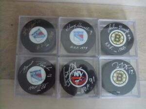 NHL-Official Licenced-AUTOGRAPHED Player Hockey Pucks.
