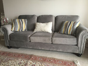 Sofa and love seat set with pilows