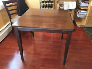 All wood dining table and matching seats