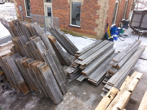 Barn board and beams for sale.  Grey board, brown board, beams.