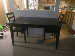 Solid wood dining table and two chairs