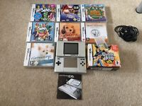 Nintendo DS with games and charger