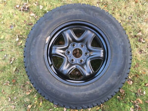 4 studded Firestone tires on rims (with pressure sensors)