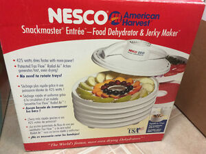 Nesco food dehydrator with extra trays, fruit roll up trays and