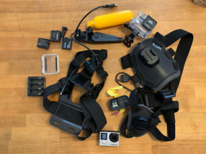 GoPro Hero 4 Silver with touchscreen, extra batteries & acces..