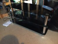 Black Glass TV Stand With Silver Cylinder Centres