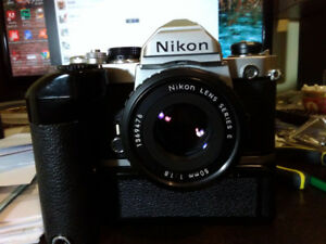 Nikon FM film camera with md 12 motor drive.