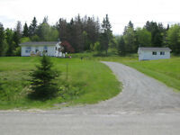 Beautiful Bungalow on manicured, garden filled 2+ acre property