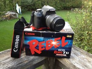 Canon Rebel T1i 35mm Camera with accessories and carrying case.