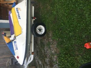 2 90s seadoo 580s on a double trailer