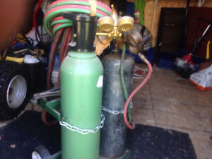 Acetylene and oxygen welding tanks and torch set.