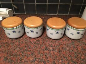 A set of 4 storage jars