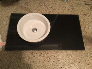 Quartz countertop with top mounted sink