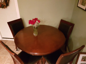Beautiful hardwood 4 chairs and a table