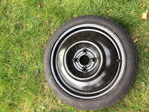 Spare tire. T115/70  D15.   Brand New