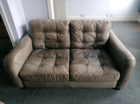 2x 2 seat grey leather sofas with storage footstool