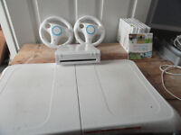 Nintendo Wii game with nunchuks, balance board & assorted games