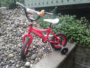 sturdy 12 inch bicycle with training wheels and bell