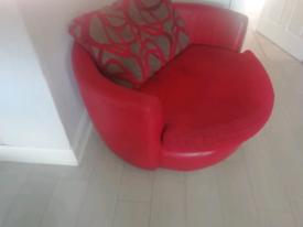 Red leather cuddle swivel chair grey cushion